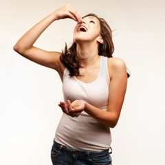 Young Woman Eating Nuts
